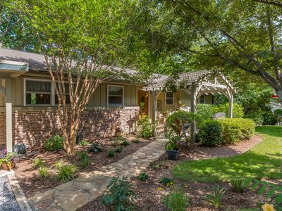 Photo for Families love this quiet setting with loads of shade trees and a charming patio.