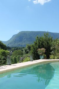 Photo for Charming stone cottage with sauna, pool, near the Grand Colombier and lakes