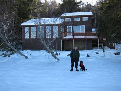 Guests in front of house in winter