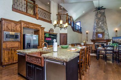 Gourmet kitchen with deluxe appliances, viking gas range and large granite bar