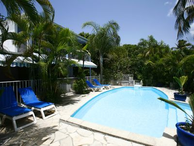 Photo for Air-conditioned studio with terrace in residence with pool, feet in the water