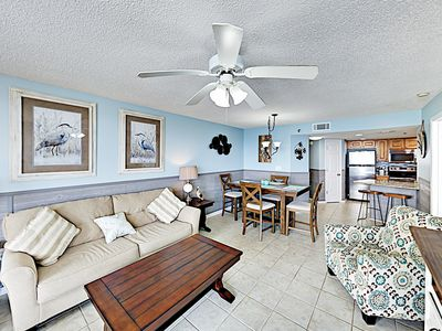 Living Area - Welcome to Orange Beach! All new furnishings, tile flooring, and beach-inspired decor fill a well-lit open living area.