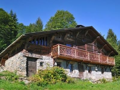 Photo for Grand Alpine chalet 300 m2 comfortably 25 people Cordon (74)