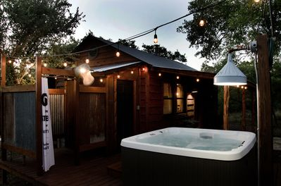 The back deck features the deluxe hot tub and outdoor shower