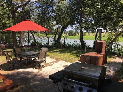 Still a lake and two grills
