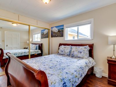 Photo for Dog-friendly beach escape with a prime seaside location and room for a family