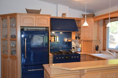 Kithcen with goumet gas stove and fridge. Also has dishwasher and microwave.