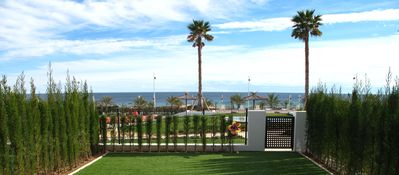 Photo for Seafront apartment with terrace, garden and sea views
