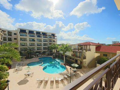 Photo for Amazing view of Aruba's Blue Skies, Charming Balcony overlooks beautiful Pool and Garden
