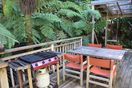 Enjoy a BBQ on the large deck in the bush