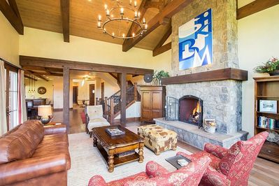 Castellina A - Gas fireplace with large stone surround, plush seating, flat screen TV in armoire