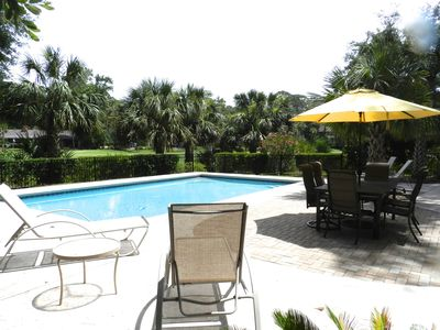 Photo for Walk to beach, pool in full sun, pet friendly, golf view, bright sunny home