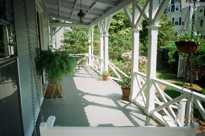 Front porch with dining table at far end