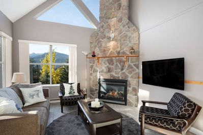 Stone fireplace, lots of natural light and great views