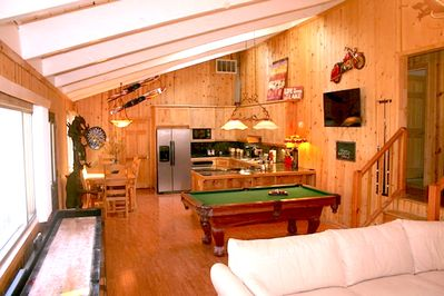 large great room. lots of room for everyone. also a wood burning fireplace too!!