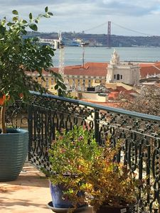 Photo for At the foot of Sao Jorge Castle, Terrace with stunning views of the city the floor