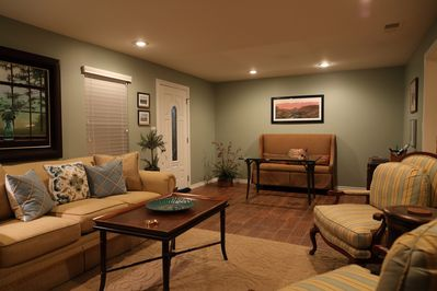 Living room has plenty of comfortable seating for social get-togethers.