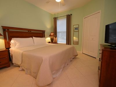 Photo for 1-107 1BR Poolside Condo just minutes from Disney World, livingroom, kitchen