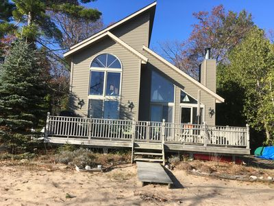 Front exterior.  Large glass windows provide great view of lake
