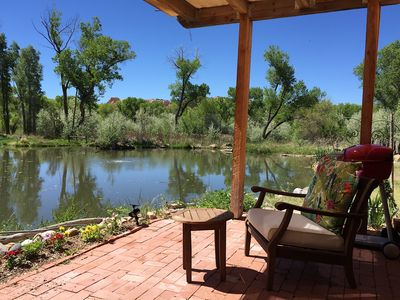 Your large private patio with grill and comfortable seating on the pond