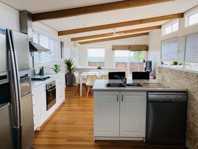 Kitchen through to dining, lounge and water views