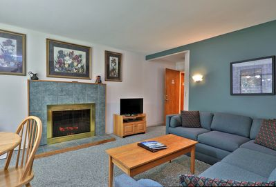Enjoy the cozy living room with an electric fireplace.