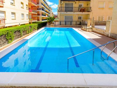 Photo for 3 bedroom Apartment, sleeps 6 with Pool and Walk to Beach & Shops