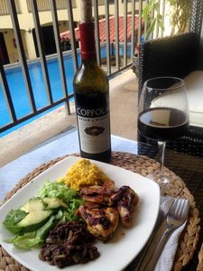 "Indulging Homemade ""Casado"" & Red Wine on my semi-private deck."