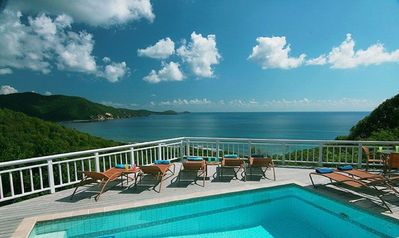 It's time to relax in the lounge chairs by the pool and enjoy the easterly view