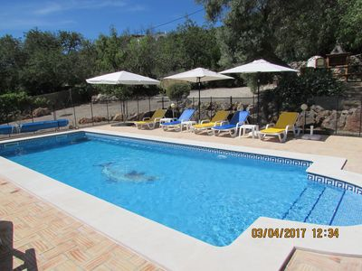 The spacious pool has a generous seating area and child-friendly safety fences.