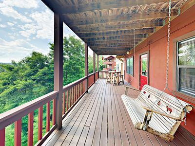 Deck - The lower-level covered deck is furnished by a porch swing.