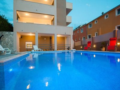 Photo for 341 m from the center of Podstrana with Internet, Pool, Air conditioning, Parking (740118)