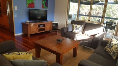 Spacious and comfortable lounge overlooking bush with Foxtel on TV