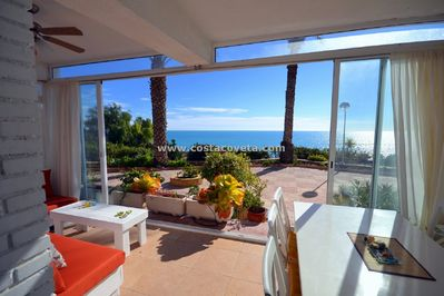 Living room and sliding doors to a large terrace at the seaside!!