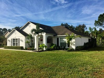 Photo for Private location and modernized villa with pool just minutes from Disney