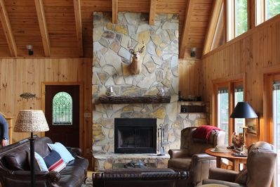 Main Level Living Room with Wood Burning Fireplace(Now with Flatscreen TV