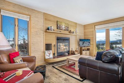 Gather Around The Fireplace While Taking In The Amazing Views