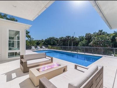 Photo for Stunning new beach home. Short walk to village. Total privacy!!