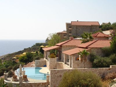 Photo for Attractive villa with a large pool and private sea access - stunning view