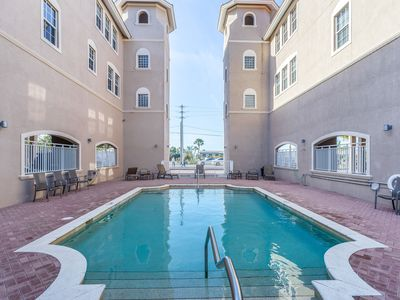 Photo for Walk to beach & enjoy a shared pool from the comfort of this waterfront condo