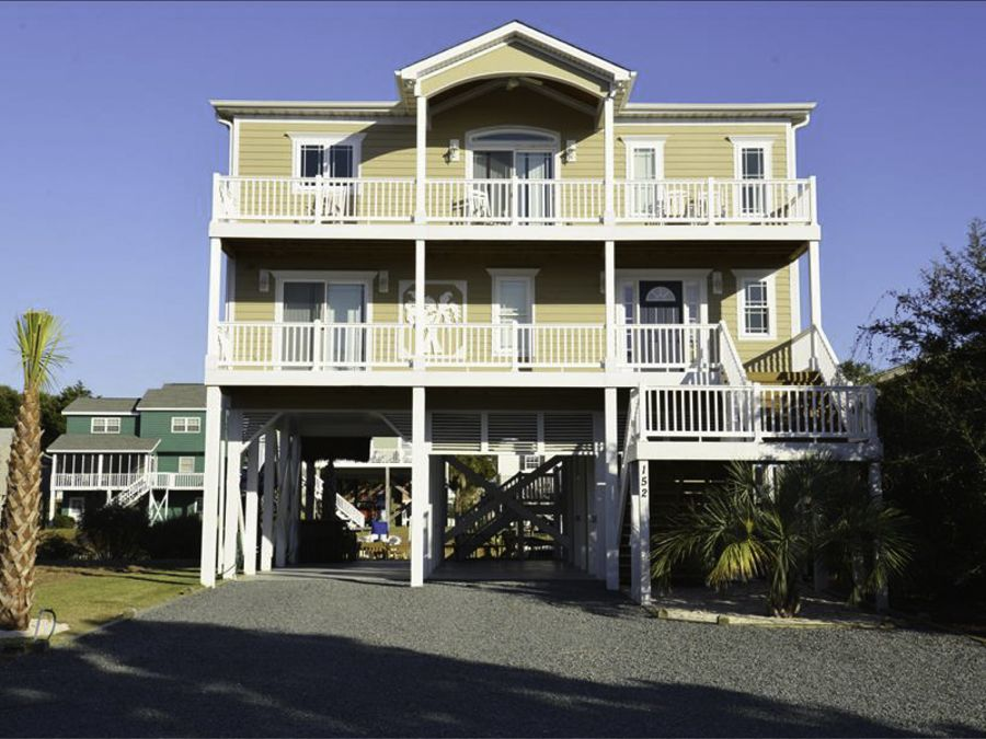 Sand happens a canal front elevator hot vrbo for Canal front home designs