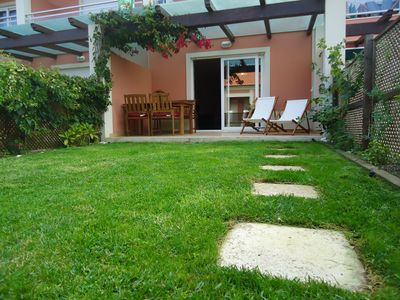 Photo for Charming and modern apartment with private garden near the beach of São Julião