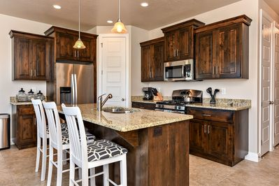 Kitchen - The Kitchen is complete with everything you will need for meal preparations including pots, pans, baking dishes, plates, cups, silverware, cutlery, and an assortment of cooking utensils.