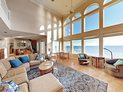 Living Room - Floor-to-ceiling windows provide stunning beach views in the living room.