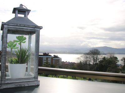 Photo for Beautiful apartment with amazing views over the bay and the city