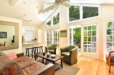 The Great Room vault-ceiling and expansive windows lend an airy openness.