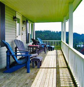 Covered porch is a lovely place to take in the views of the Atlantic.