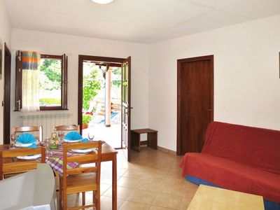 Photo for Lovely apartment in villa for 9 guests with pool, WIFI, TV, balcony, pets allowed and parking
