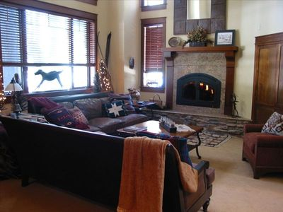 Main Floor Family Room with Wood Burning Fireplace and Golf Course Views