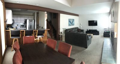 panoramic view of the kitchen/living room/dining room/stairs up to second floor